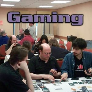 Three tables of people playing games